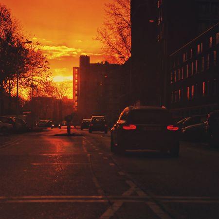Streetphotography Amsterdam Sunrise_sunsets_aroundworld Sunrise Early Morning Orange Sky Car Sunset Street City Transportation Land Vehicle Architecture Outdoors Road Sky No People