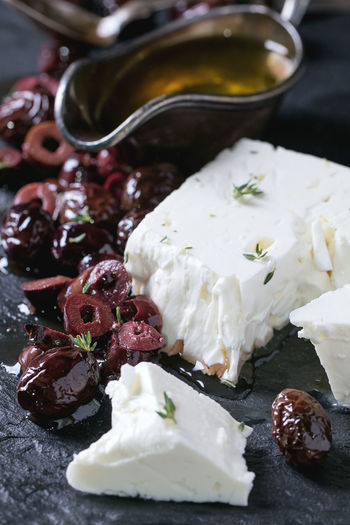 Close-up of black olives and feta cheese on table