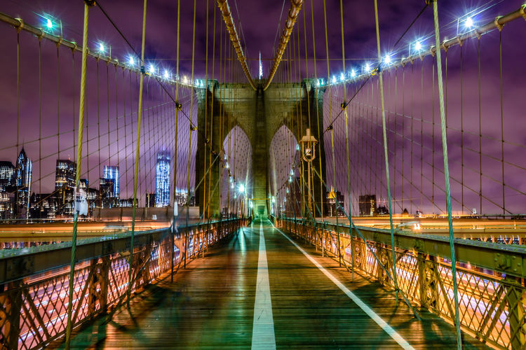 Illuminated brooklyn bridge at night