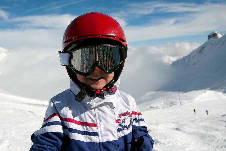 Portrait of boy wearing sunglasses in mountains