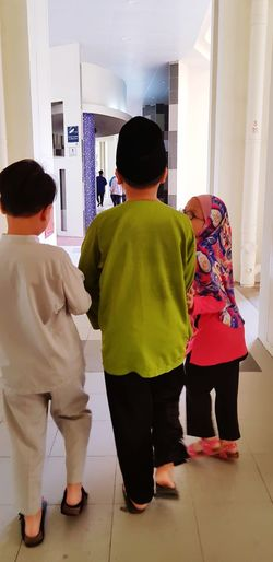 3 kids happily walking along the corridor Child Full Length Childhood Males  Boys Togetherness Living Room Men Standing Females Sibling Sister Brother Elementary Age Children Girls