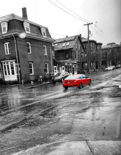 Red car in the rain ~ in Portland Maine USA My Uniq In Portland Maine USA Springtime No People Color Of Life Loving The Landscape Lifestyles Lights And Reflection Weather Conditions Giant Puddle City Water Car Road Wet Isolated Color Rainfall Thunderstorm