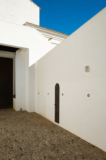 Ronda Ronda Spain Minimal Minimalism Minimalobsession Minimalist Architecture The Week on EyeEm Minimalist Built Structure Architecture Building Exterior Building Sky No People Nature Clear Sky Day Sunlight White Color Entrance Low Angle View Door Wall - Building Feature Outdoors Blue Land Sand Sunny