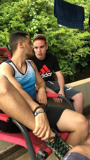 Surprise Nike Adidas Hollidays Vacations Teamwork Activity Teaching Learning Attention Two People Sitting Togetherness Leisure Activity Young Men Men Real People