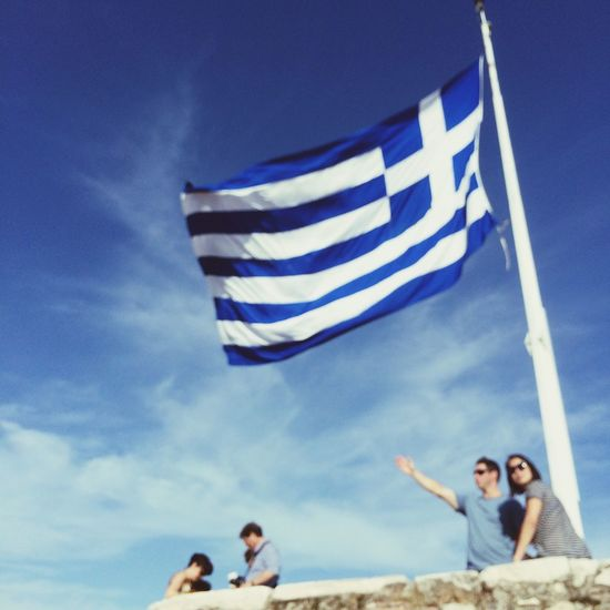 Welcome to Greece! Athens, Greece. Photo by Tom Bland. Sky Blue Flag Real People Outdoors People IPhone IPhoneography Travel Greece Greek Flag Soft Out Of Focus Tourism Tourists Athens Athens, Greece Blue Sky Europe Europe Trip Hellas Traveling Travel Photography