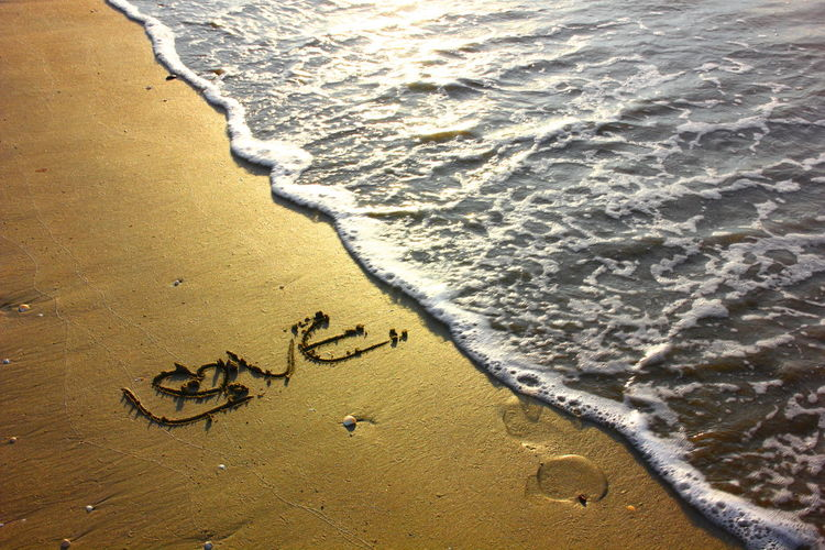 love on beach with sea wave Beach Water Land Sea Wave Sand Surfing Nature Text Day