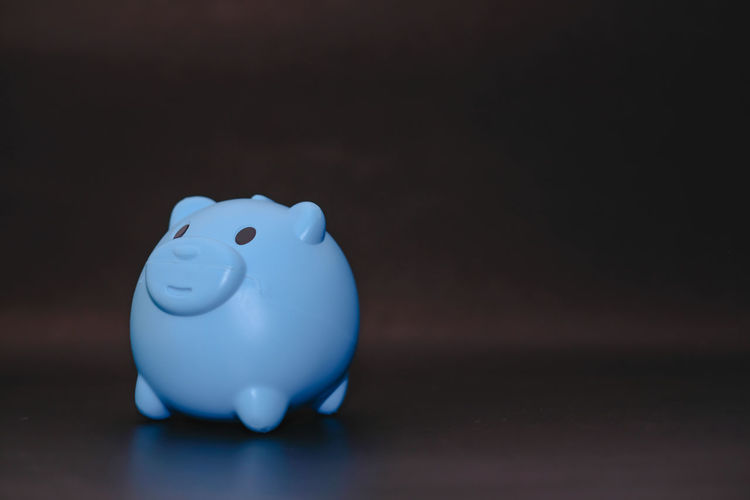 Close-up of toy on table against blue background