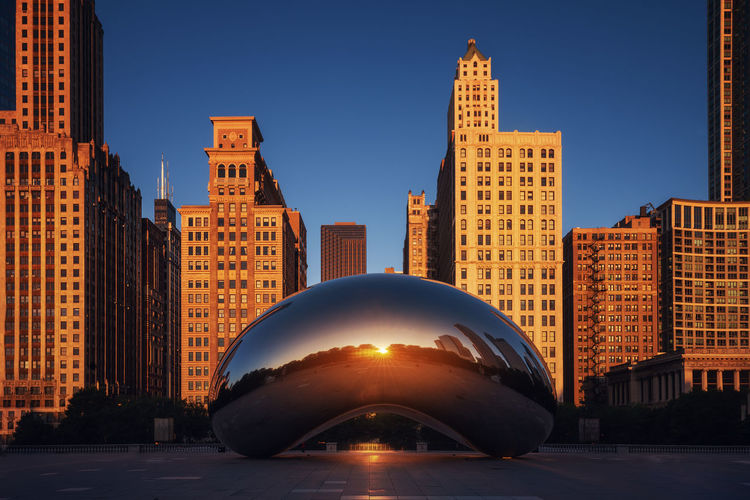 """The """"Bean"""" in Chicago Building Exterior Built Structure Architecture Sunlight No People Office Building Exterior Building Travel Destinations Tall - High Tower Blue Cityscape Clear Sky City Sky Sunset Skyscraper Modern Outdoors"""