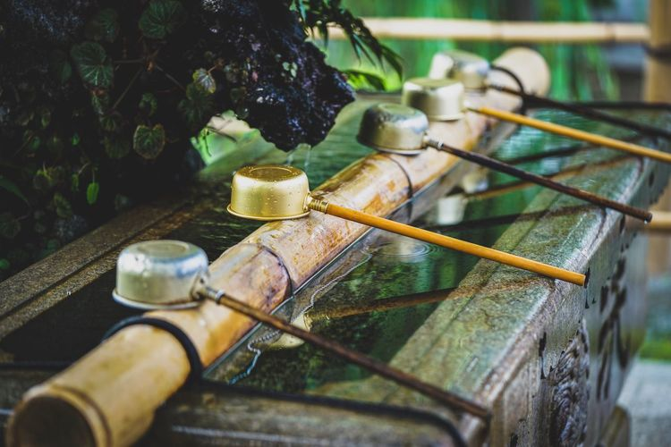 Close up of ladles on bamboo