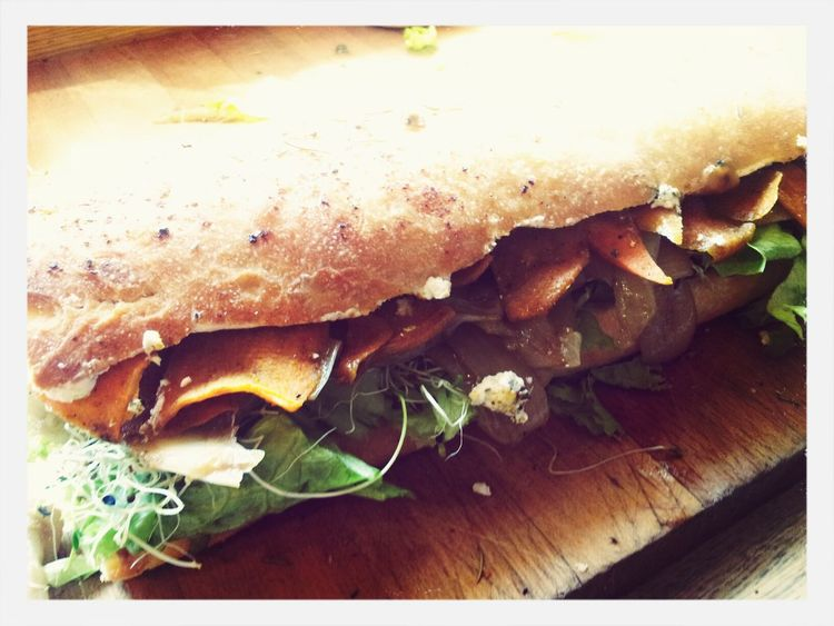 Goat Cheese sandwhich featuring spicy sweet potatos, caramelized onions, pesto, lettuce, and sprouts. First Eyeem Photo