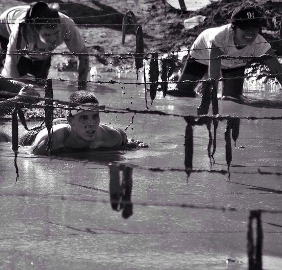 Soldiers undergoing training in mud