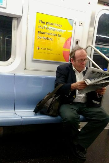 On the 7 train.photo by Shell Sheddy Public Transportation Mode Of Transport Businessman Passenger Journey Commuter Documentary Photography Shellsheddyphotography Sheshephoto Street Photography Connected By Travel Newspaper Variation News Sitting Train - Vehicle This Is Masculinity