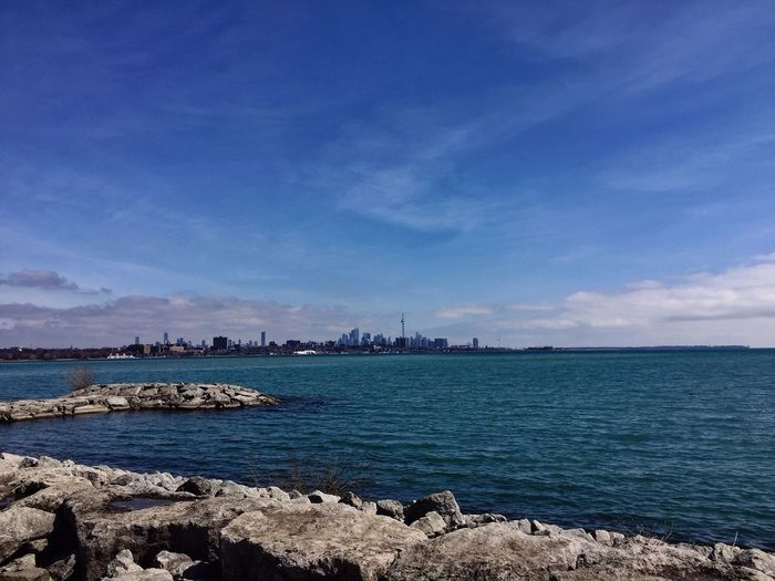 Distant View Of City In Lake Ontario Against Sky