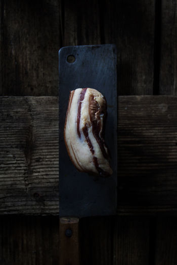 Wood - Material Food And Drink Food Indoors  Freshness No People Table Still Life Close-up Wellbeing Animal Wood Meat Dark Indulgence Healthy Eating Studio Shot Directly Above Selective Focus Processed Meat Temptation Bacon