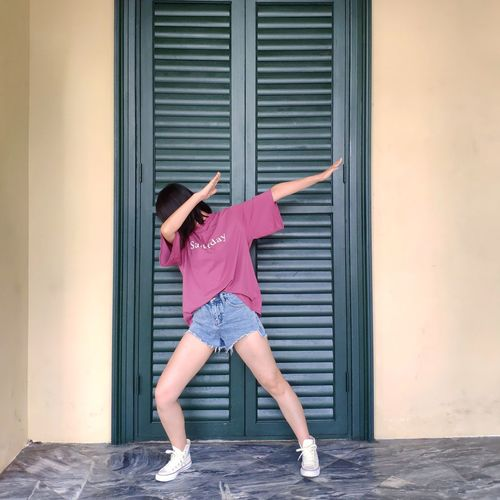 Woman dabbing against closed door