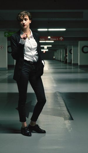 Full length of man standing in corridor