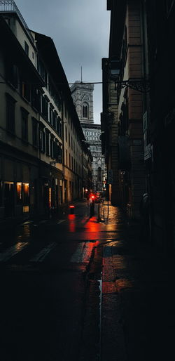 City street amidst buildings during rainy season