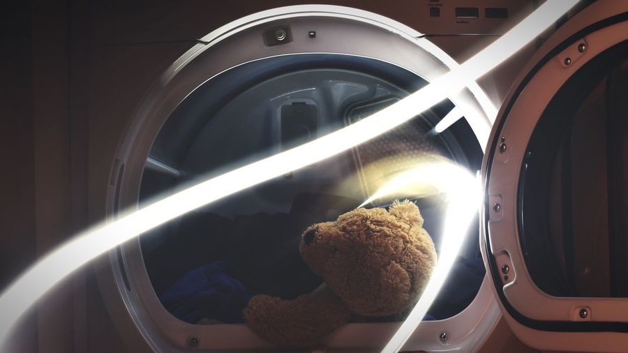 Close-up of teddy bear in washing machine by light painting