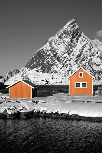 Lofoten Islands, Norway Norway Paint The Town Yellow Architecture Beauty In Nature Black And White Blackandwhite Building Exterior Built Structure Cold Temperature Day House Lofoten Mountain Nature No People Outdoors Scenics Sky Snow Snowcapped Mountain Water Winter Yellow
