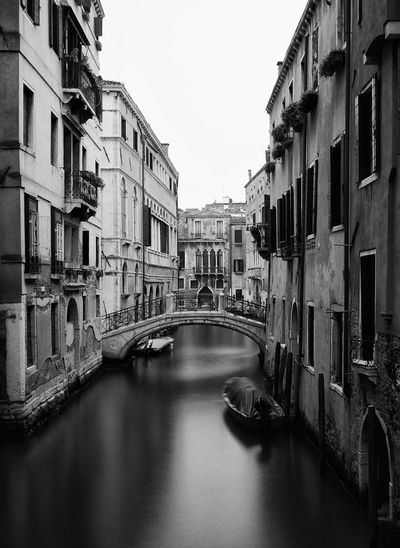 Canal B&W Arch Architecture Architecture Boat Bridge - Man Made Structure Building Building Exterior Built Structure Canal City Clear Sky Connection Day Fujifilm X-Pro1 Italy Long Exposure Reflection Residential Building Residential Structure River Transportation Travel Water Waterfront