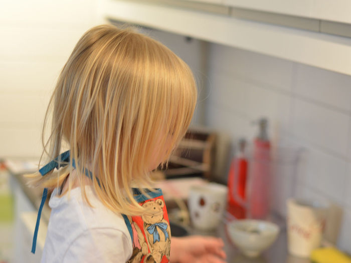 Blond Girl Blond Hair Child Child Baking Child Cooking Childhood Close-up Day Focus On Foreground Girl Cooking Girl Power Headshot Indoors  One Person One Young Woman Only People Not Identifiable Kitchen Kitchen Aid