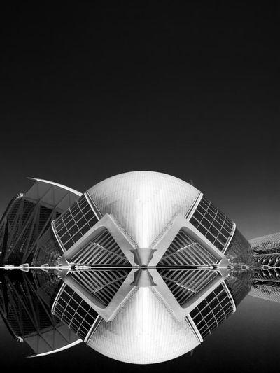 Tilt image of ferris wheel against sky