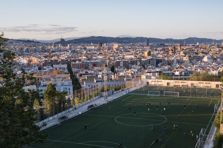 Barcelona, spain. high angle view of soccer field against sky in city