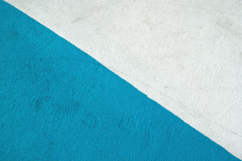 Blue and white textured surface of asphalt for abstract background, top view. Asphalt Bright Copy Space Diagonal LINE Textured  Abstract Art Background Blue Colorful Contrast Flat Lay Geometry Gray Half Minimalism Pattern Simple Sky Stone Street Surface Triangle White Color