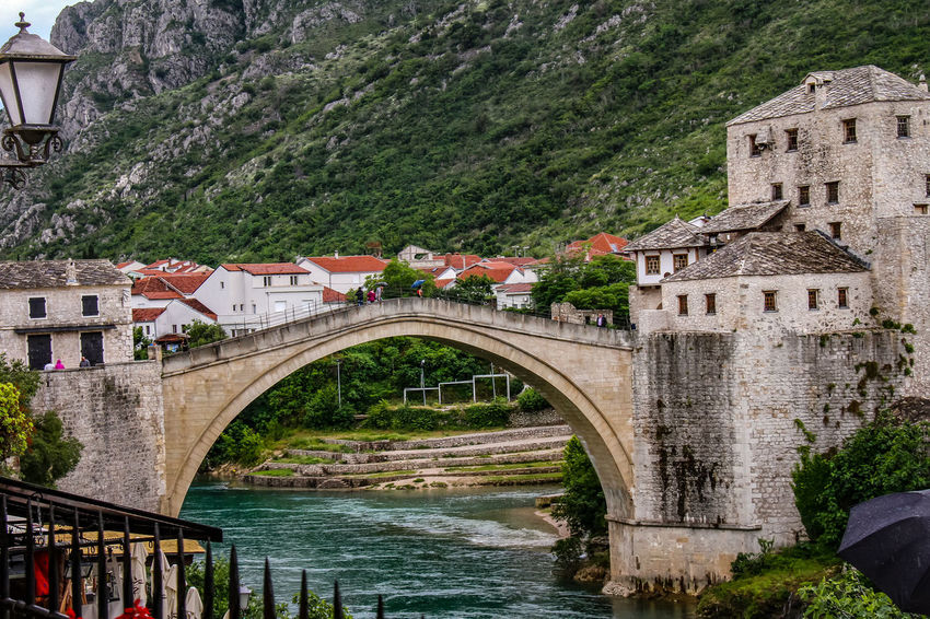 Mostar Mostar Bosnia Mostar Bridge Arch Architecture Bridge - Man Made Structure Building Exterior Built Structure Connection Day History Nature Neretva River No People Outdoors River Sky Travel Destinations Tree Water