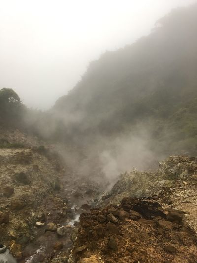 Dominica Valley Of Desolation Beauty In Nature Boiling Lake Walk Day Fog Geology Landscape Mountain Nature No People Outdoors Physical Geography Power In Nature Scenics Sky Smoke - Physical Structure Steam Tranquility Volcanic Landscape