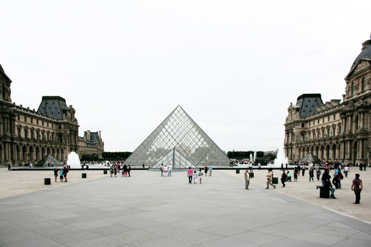 People Pyramid Shape At Louvre Museum Against Clear Sky