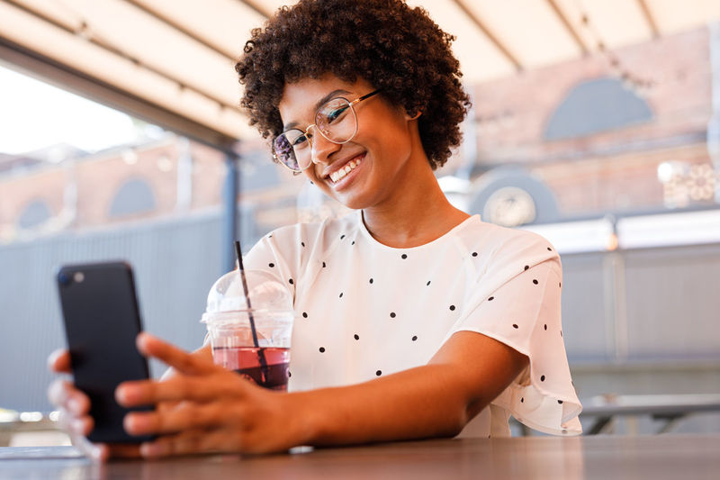 Podcast Vlogger Blogger Content Influencer Young Girl Portrait One Person Selfie Looking At Camera Real People Lifestyles African Outdoors Day Front View Camera Happy Smiling