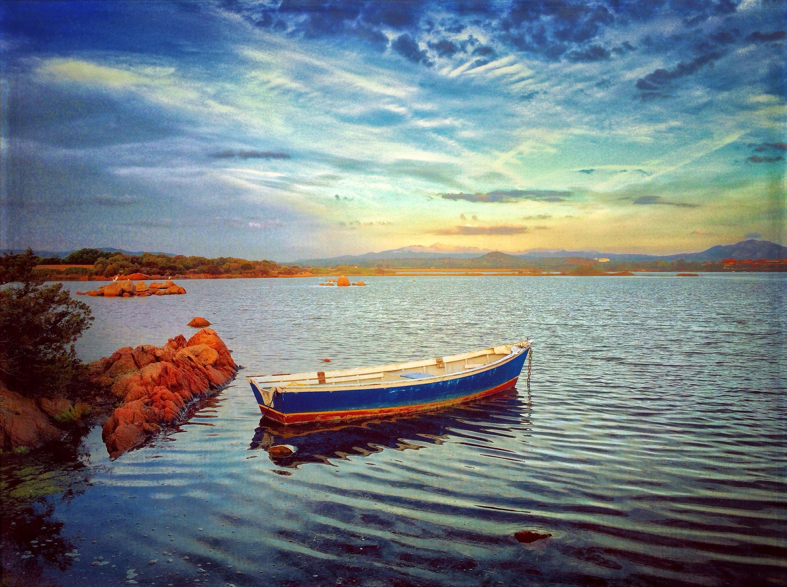 water, sky, tranquil scene, tranquility, scenics, beauty in nature, nautical vessel, boat, sea, cloud - sky, nature, transportation, lake, waterfront, idyllic, cloud, sunset, rippled, calm, moored