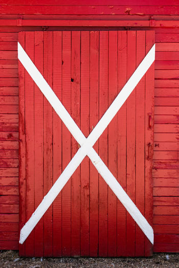 Cross shape on closed wooden barn door