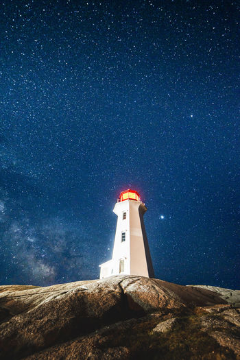 Peggy's Cove, NS / Canada - May 12 2018: Stars over Peggy's Point Lighthouse Architecture Astronomy Astrophotography Building Building Exterior Built Structure Canada Direction Guidance Lighthouse Low Angle View Milky Way Nature Night No People Nova Scotia Outdoors Safety Scenics - Nature Sky Space Space And Astronomy Star - Space Tower