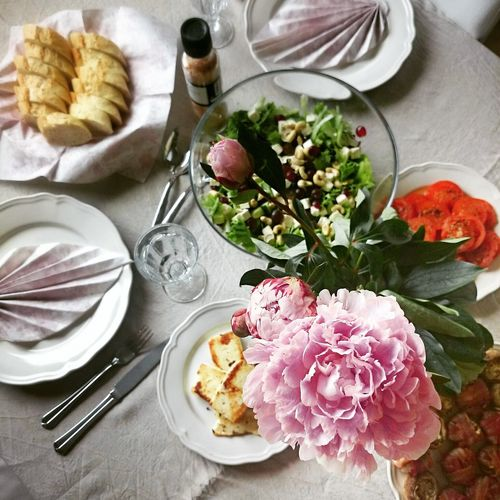 High Angle View Of Meal Served On Table By Flowers