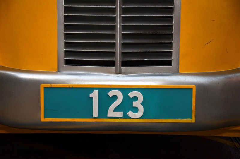 Number 123 on yellow bus