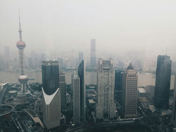 High Angle View Of Oriental Pearl Tower And Buildings In City