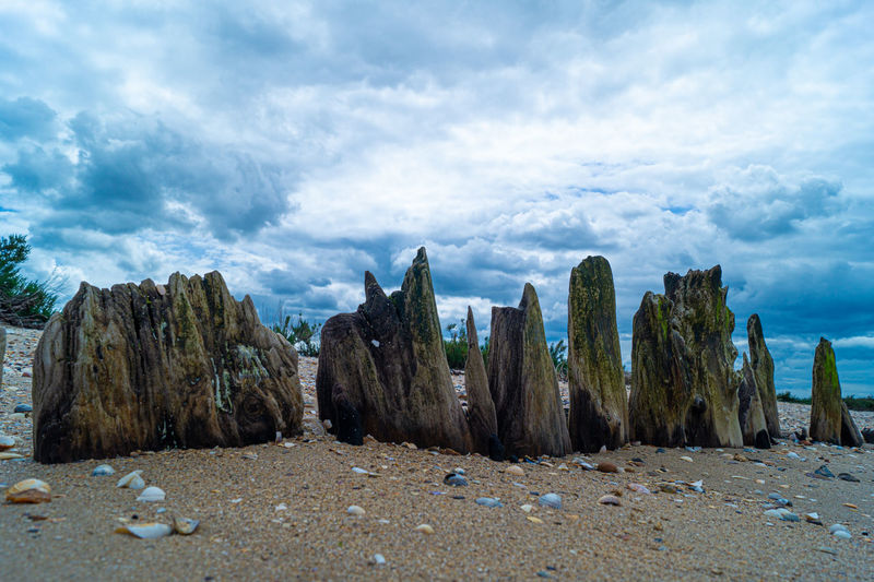 Panoramic shot of rocks on beach against sky