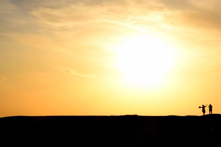 Been There. Sunset Silhouette Orange Color Sun Nature Sky Beauty In Nature Real People Scenics Tranquil Scene Desert China Yardang Landform Field Lifestyles Leisure Activity Sunlight Men Landscape Standing People Paint The Town Yellow