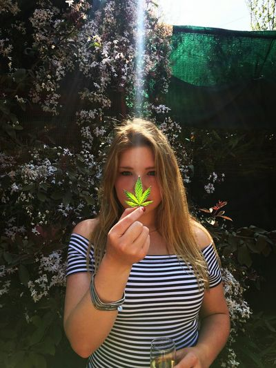 Peace in botany 🌱 Adults Only Young Adult Waist Up Adult One Person Only Women People One Young Woman Only Young Women Outdoors One Woman Only Day Marijuana Mary Jane Cannabis Optical Illusion Light Effect Light And Shadow Sun Rays Peace In Botany Herbal