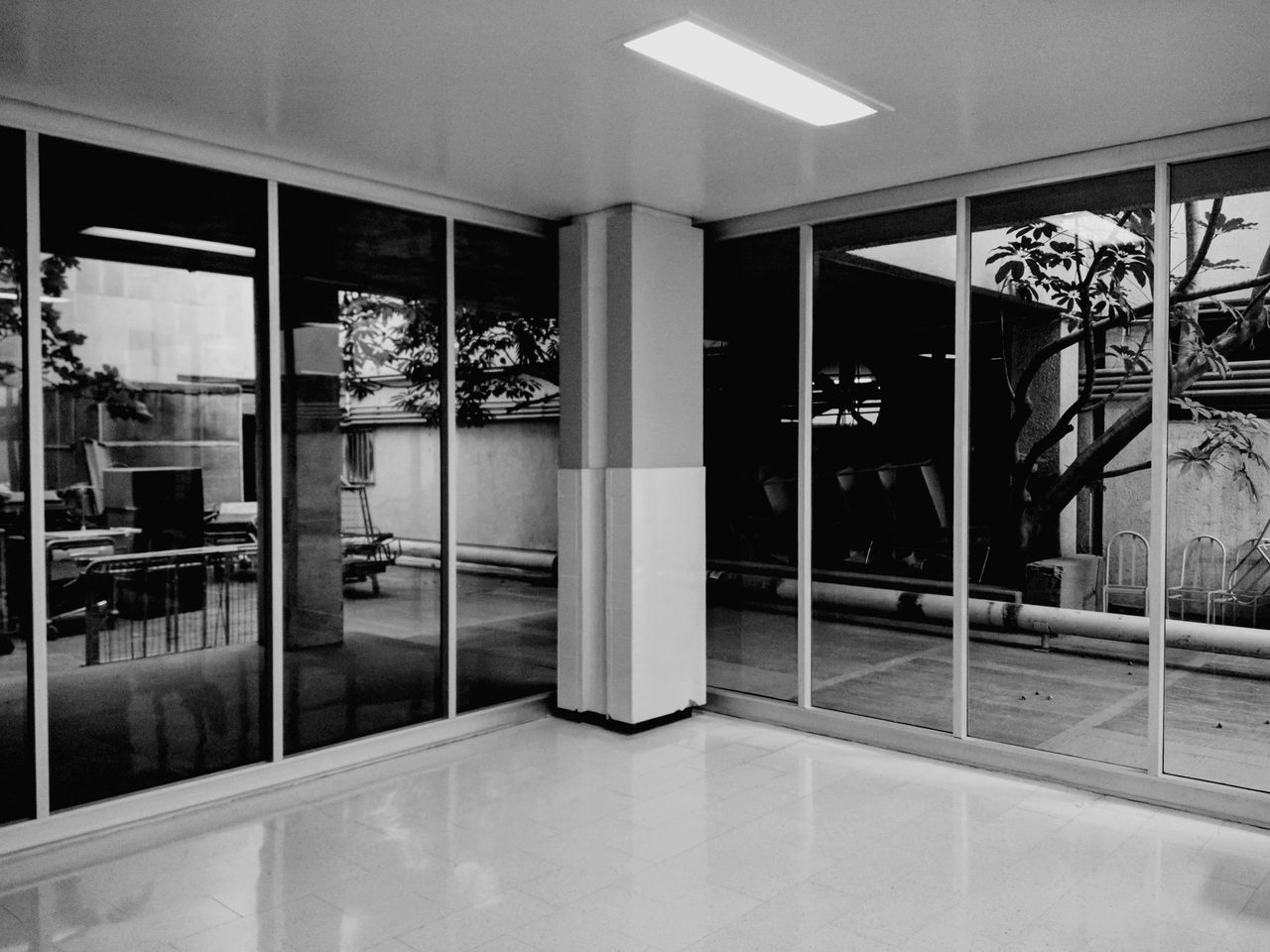 entrance, indoors, reflection, store, tiled floor, no people, architecture, luxury, home showcase interior, open door, modern, day