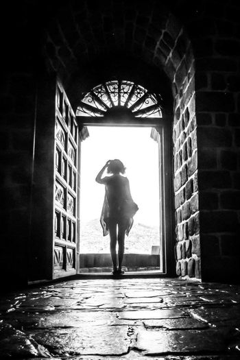 Live For The Story Full Length Real People Architecture One Woman Only Alone Silhouette Future In Front Of Me Standing Open Door Cobblestone Live For The Story