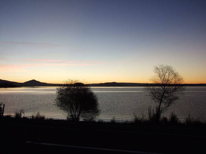 Beauty In Nature Clear Sky Day Lake Taupo Nature New Zealand Landscape No People Outdoors Road Scenics Silhouette Sky Sunset Tranquil Scene Tranquility Tree Water