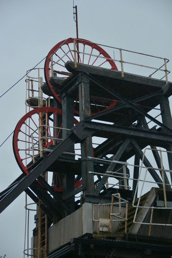 Architecture Built Structure Clear Sky Coalface Collery Dark Satanic Mills Day Ferris Wheel Lift Mechanism Low Angle View Machinery Mining Industry No People Outdoors Red Wheel Sky South Wales Water