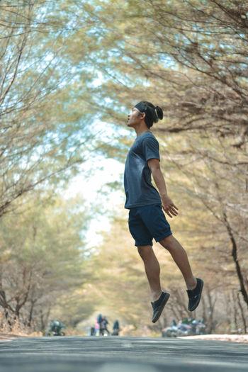 Full length of man running on plant