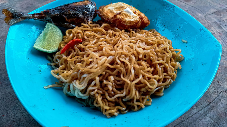 High angle view of noodles in plate on table