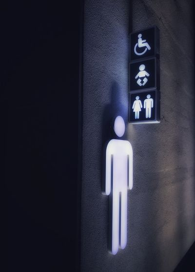 Urban amenities Urban Architecture Communication Indoors  Sign No People Symbol Wall - Building Feature Human Representation Close-up Technology Entrance Restroom Sign Healthcare And Medicine Information Dark Built Structure