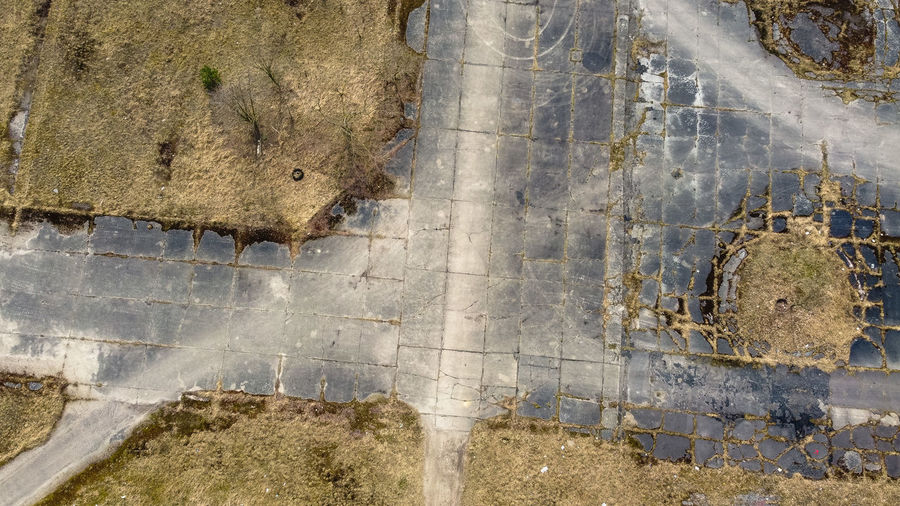 High angle view of abandoned puddle on road