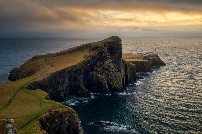 Neist Point, Isle of Skye - Scotland Sea Water Scenics - Nature Sky Beauty In Nature Cloud - Sky Horizon Over Water Rock Horizon Tranquility Beach Land Tranquil Scene Rock - Object Nature Sunset Solid Cliff Coastline No People Outdoors Rocky Coastline Neist Point Lighthouse
